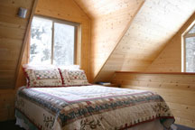 One of three comfy queen beds at Ridgerunner Cabin, Taos Ski Valley